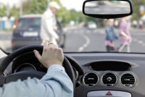Driver and pedestrians at a crosswalk