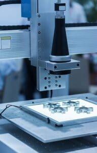 Robot examining camera in factory